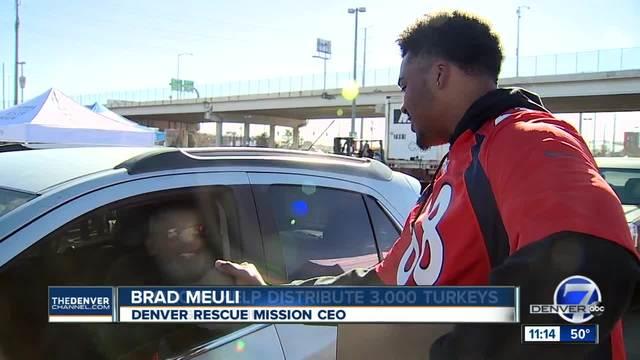 Image result for Broncos help Denver Rescue Mission give out turkeys for Thanksgiving